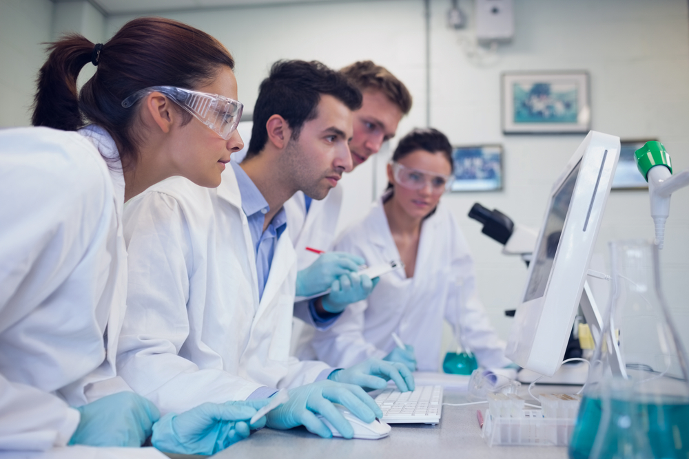 scientists looking at cell cultures