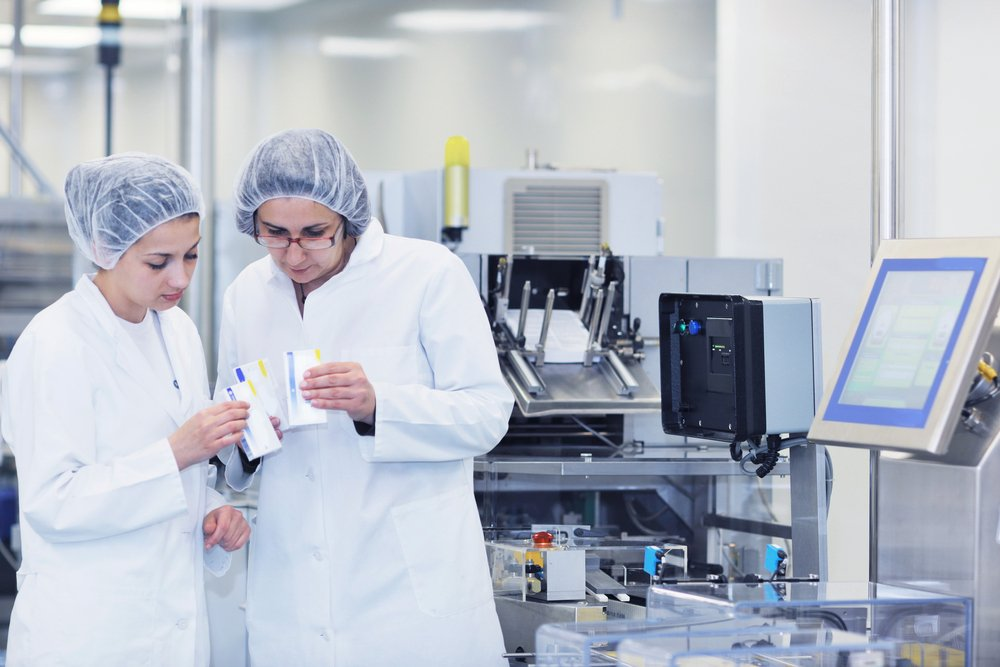 two scientists analyzing samples